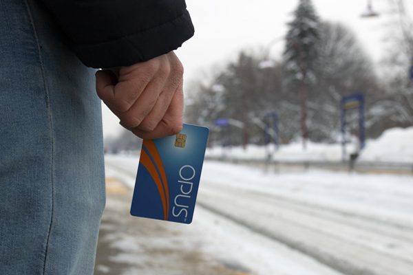Commuter waits for train with Opus card