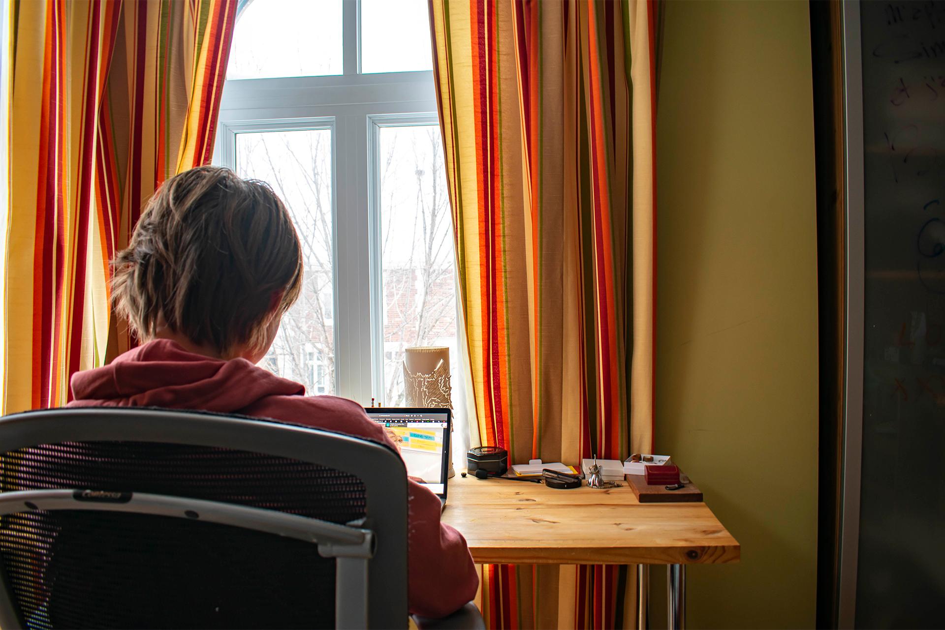 Simon Duchaine-Morneau sits at his computer.