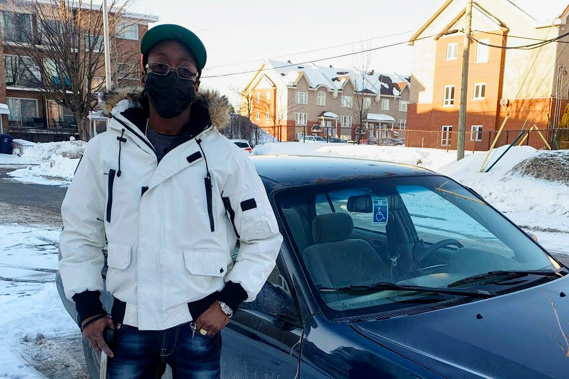 Pradel Clement stands in front of his car in Laval.
