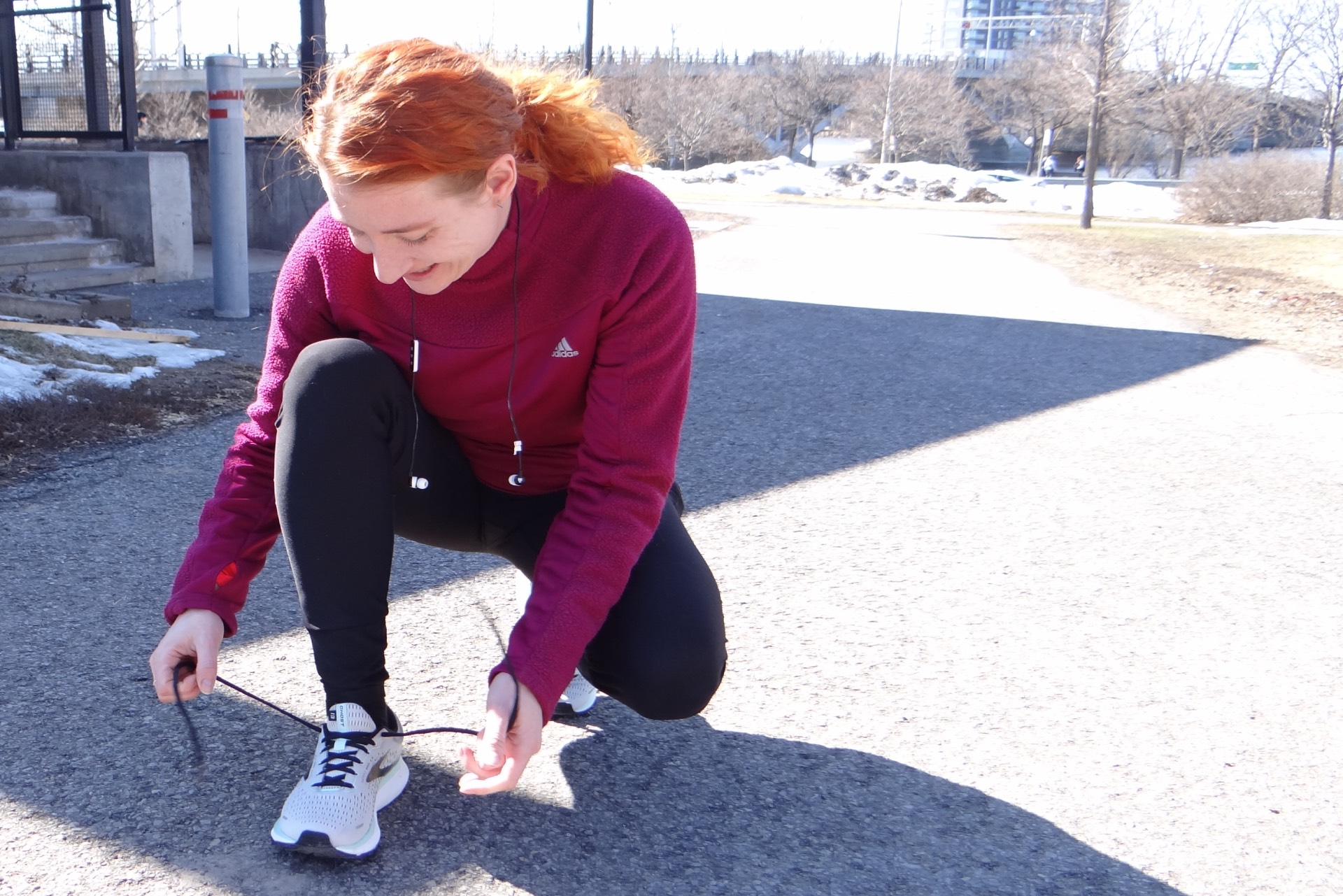 Heather Stacey ties her running shoes.