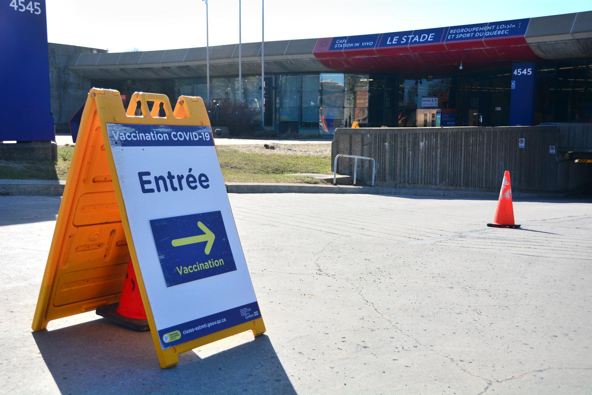 A vaccination centre entrance sign.